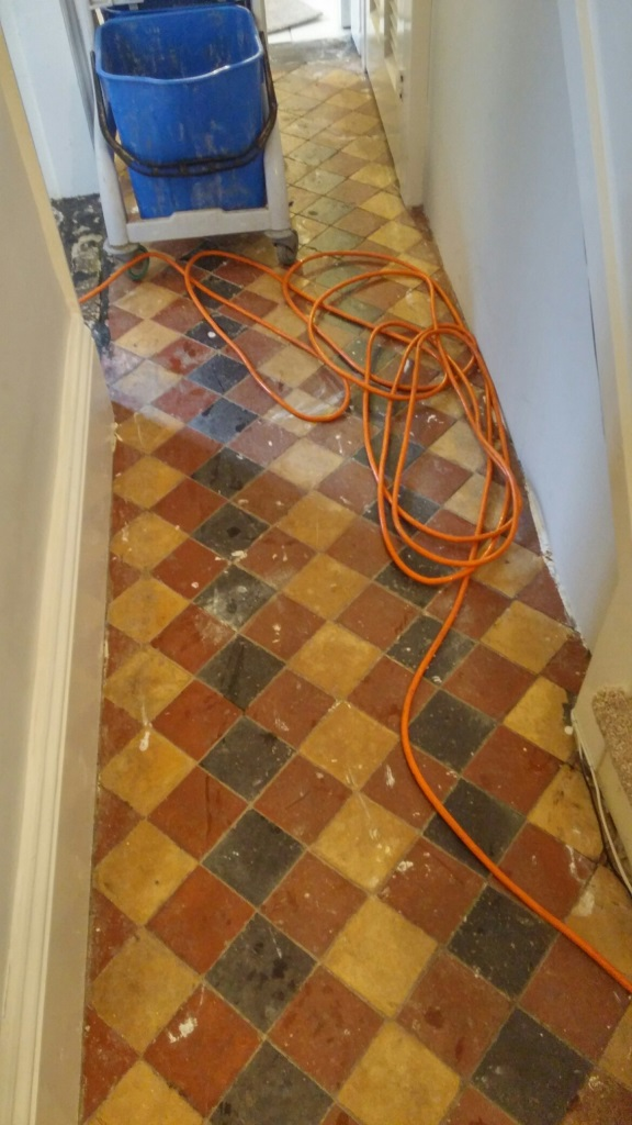 Old Victorian tiled hallway before cleaning Louth