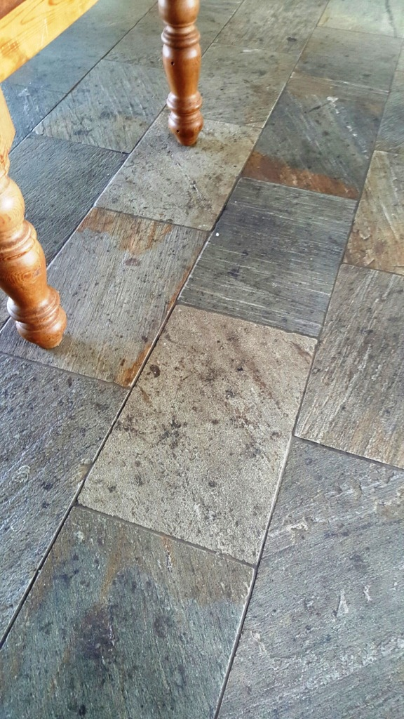 Riven slate floor before cleaning at Boston farmhouse