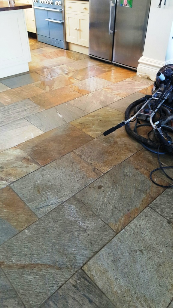 Riven slate floor during cleaning at Boston farmhouse